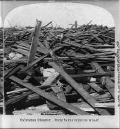 A dead body lies amongst the rubble. From the Library of Congress.