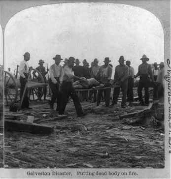Cleanup crews prepare to cremate a storm victim. From the Library of Congress.